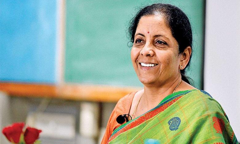 Nirmala Sitaraman sworn in as cabinet minister, కేంద్ర మంత్రిగా ప్రమాణం చేసిన నిర్మలా సీతారామన్