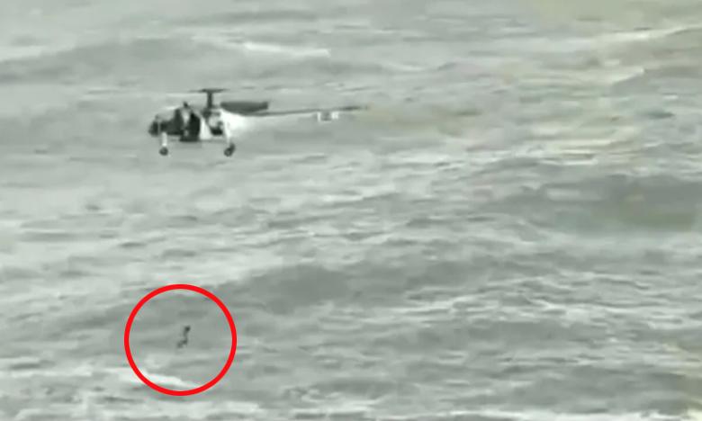 Coast Guard Helicopter Rescues Man, అలల తాకిడికి కొట్టుకుపోతే…