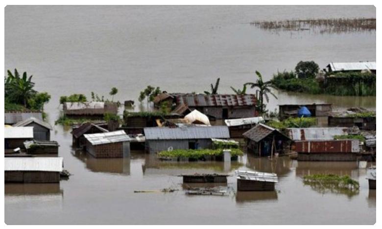 Assom floods, అసోంలో వరదలు.. జలదిగ్బంధంలో 1,556 గ్రామాలు