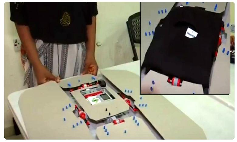 Robot that can fold clothes, దుస్తులను మడతపెట్టే రోబో!