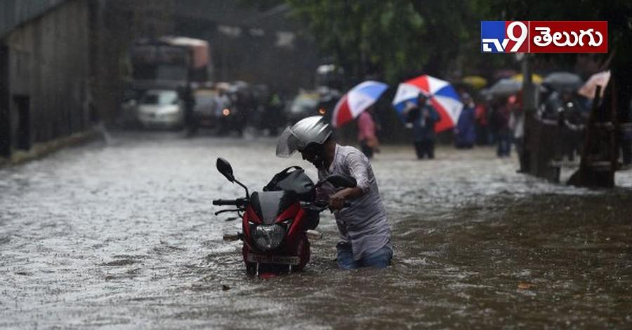 Mumbai Rains, ముంబై జలమయం..  (ఫోటో గ్యాలరీ)