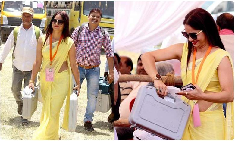 Reena Dwivedi dance viral video Lucknow election officer on duty India, డ్యాన్స్ ఇరగదీసిన ఎల్లో శారీ ఆఫీసర్.. ఫిదా అవుతున్న నెటిజన్లు
