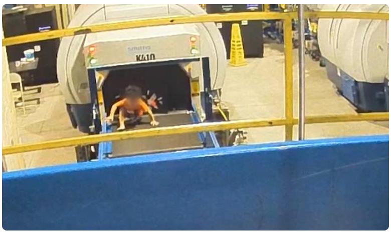 Boy injured after ride on airport baggage conveyor belt, ఎయిర్పోర్ట్లో బుడ్డోడి హంగామా.. అధికారుల గుండె గుభేల్!