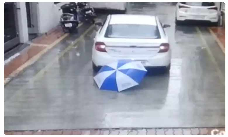 video miraculous escape for a boy in surat gujarat after coming under a reversing car