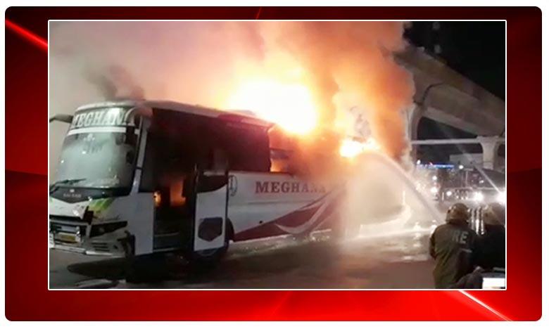 Narrow escape for passengers after bus catches fire in Kukatpally, మేఘన ట్రావెల్స్ బస్సులో మంటలు
