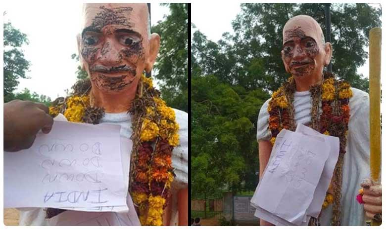 Gandhi Statue Painted In Black Posters Of Pakistan Zindabad Tension In Nizamabad Gundaram Village