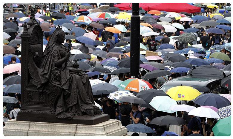 pro-democracy protests in hongkong, హాంకాంగ్ లో అదే ప్రజా వెల్లువ.. లక్షల్లో పోటెత్తిన జనం..