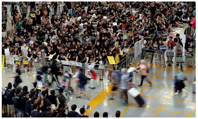 Protests in Hong Kong causes economy slide, ఆగని నిరసనలు.. కుంటుపడుతున్న ఆర్థిక వ్యవస్థ