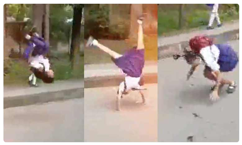 School students wonderful front jump feet on road