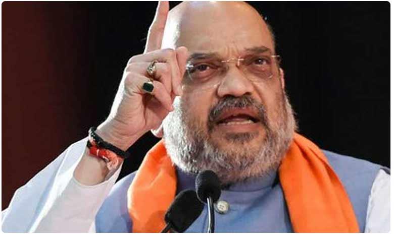 Amit shah trians guns at Rahul Gandhi