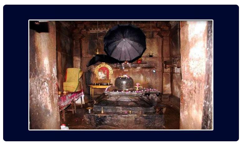 Lord shiva idol under umbrellla, గొడుగు నీడన శివయ్య ..