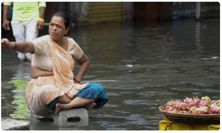 Heavy rains lash Mumbai, భారీ వర్షాలతో మరోసారి ముంబై అతలాకుతలం.. ఆరెంజ్ అలర్ట్ జారీ