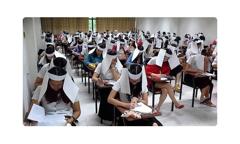 mexican teacher stops students cheating during exams by putting cardboard boxes on their heads, పరీక్షల్లో కాపీలు కొట్టకుండా.. ఇదేం పధ్దతి బాబోయ్ !