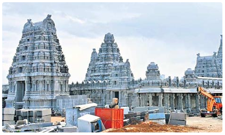 Yadadri temple controversy: Pictures removed from pillars, శిలలపై వివాదాన్ని చెరిపేసిన శిల్పులు..!