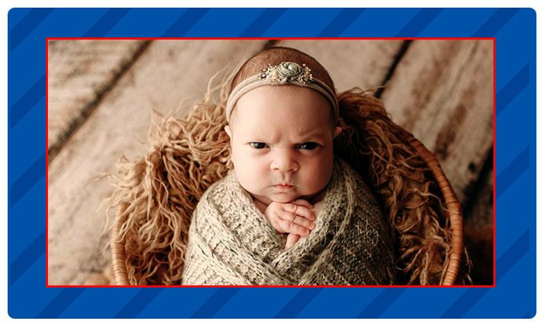 The infant's scowling face, ' ముద్దుల పాపా ! అంత చిరాకెందుకమ్మా ?'