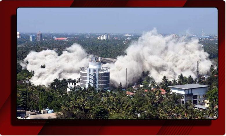 video.. flats razed with controlled explosions in seconds in kochi, రూల్స్ బ్రేక్.. కొచ్చి లోని బహుళ అంతస్తులు క్షణాల్లో నేలమట్టం