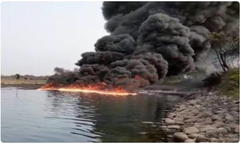 Assam River On Fire For 2 Days After Crude Oil Pipeline Bursts, తగలబడ్డ నది.. అధికారులు చెప్పిన రీజన్ వింటే షాక్…